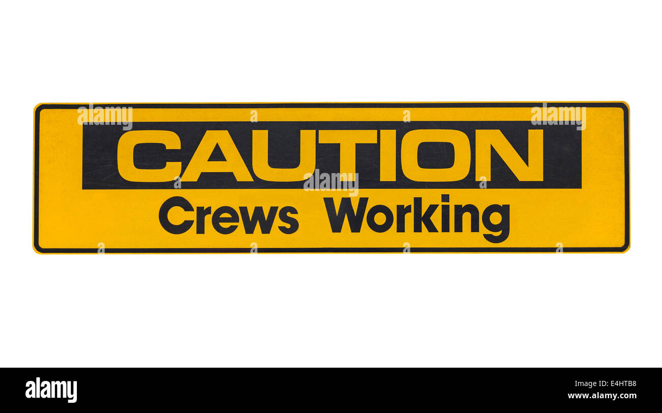 Weathered caution crews working sign isolated. - Stock Image