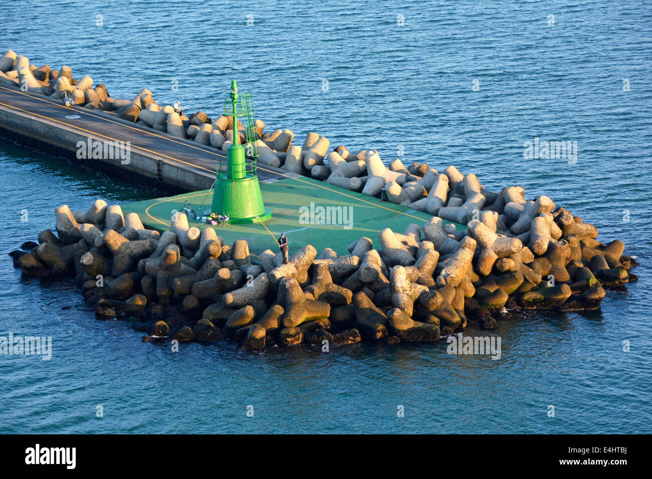Dolosse concrete blocks in sea defences to protect the green channel marker at canal entrance & Marina & - Stock Image