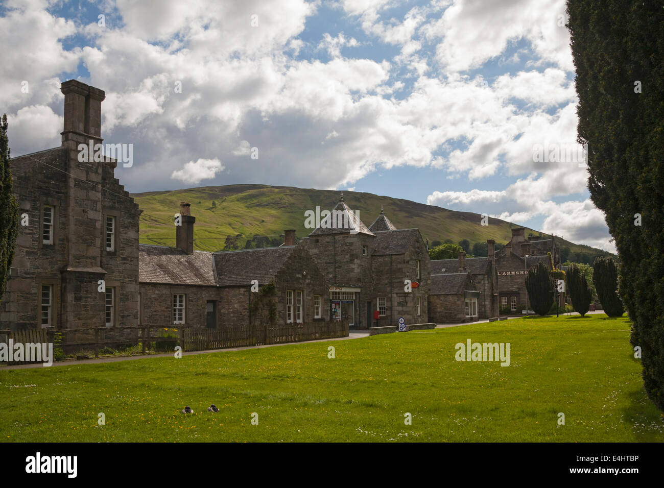 Row of substantial stone houses including the Post Office built in 1850's Blair Atholl Perth and Kinross Scottish - Stock Image