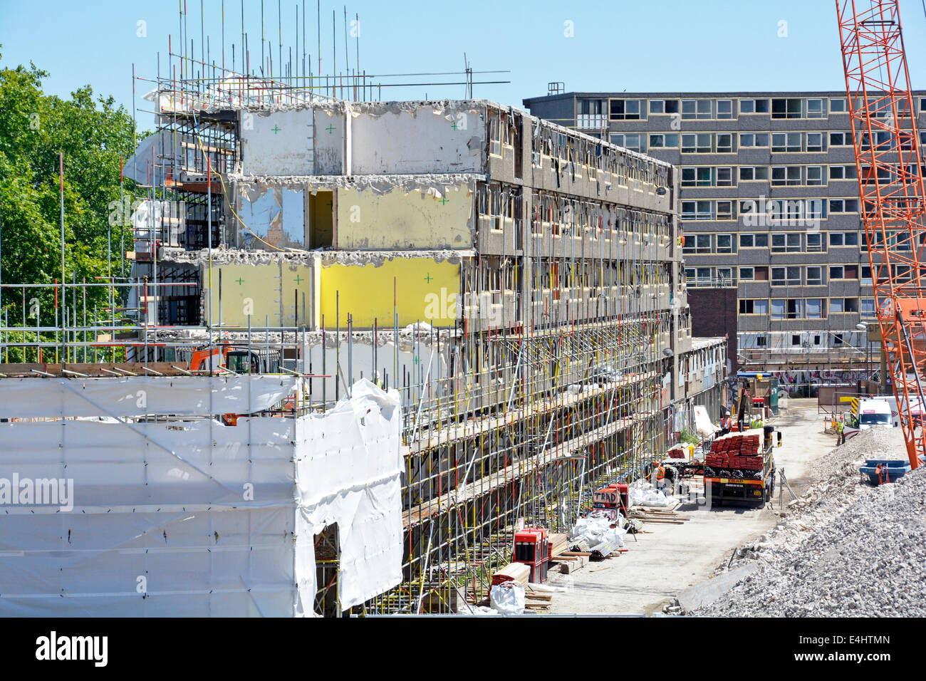 Obsolete precast concrete social housing dwellings on the Heygate Estate being demolished and cleared for redevelopment - Stock Image
