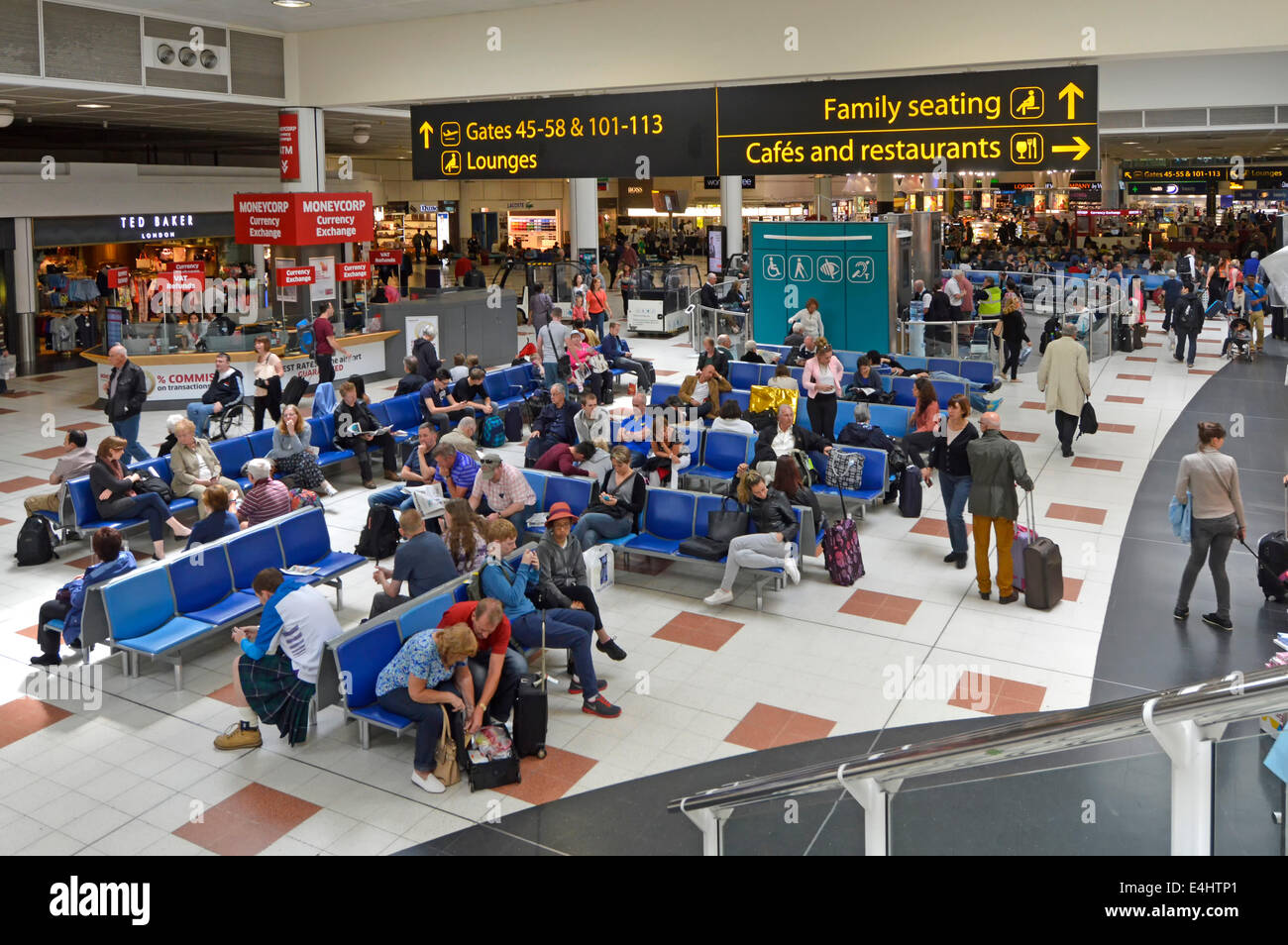 Family seating area & cafes restaurants signs at London Gatwick Airport North Terminal departure lounge and - Stock Image