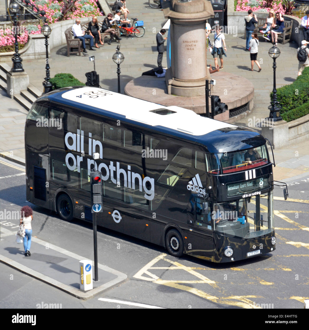 Adidas advertising on new London Routemaster Boris bus black with white roof instead of red - Stock Image