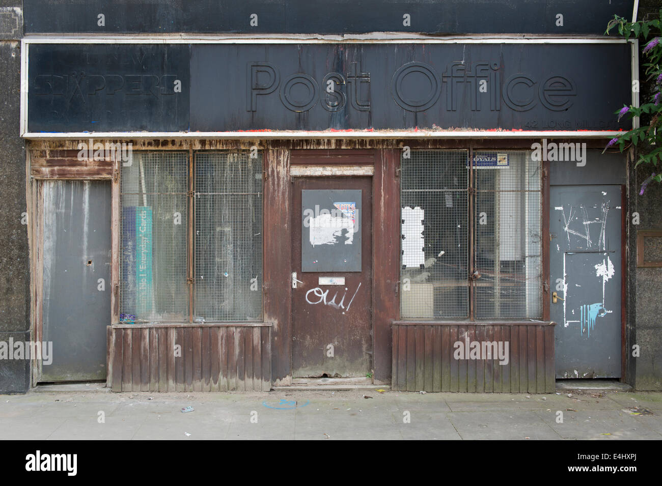 The dilapidated property of a closed down Post Office near Victoria railway station in Manchester - Stock Image