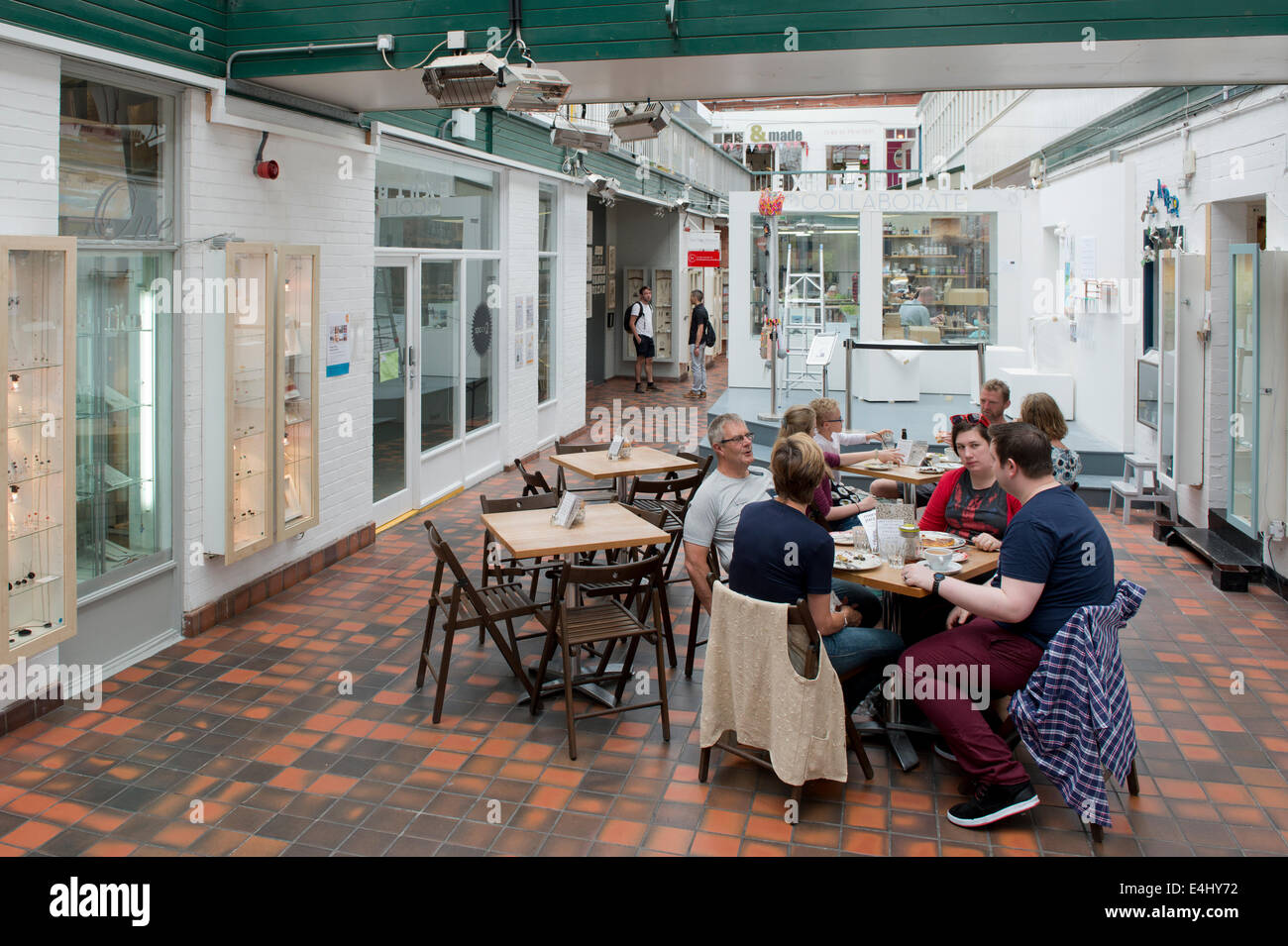 People socialise inside the Manchester Craft and Design Centre on Oak Street in the Northern Quarter, Manchester - Stock Image