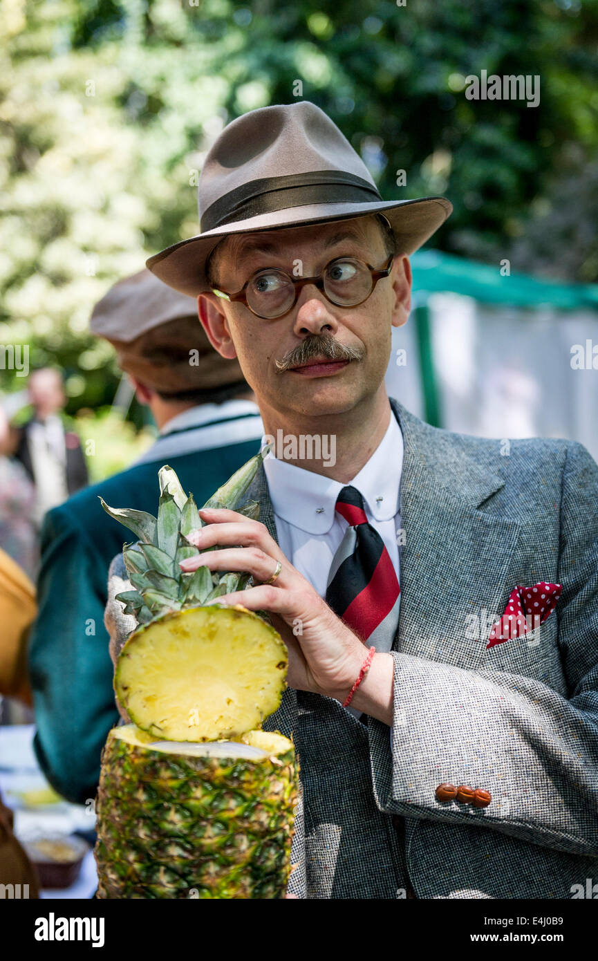 Bedford Square, Bloomsbury, London, 19th April 2014.  A chap displaying his pineapple ice bucket at the Chap Olympiad. - Stock Image