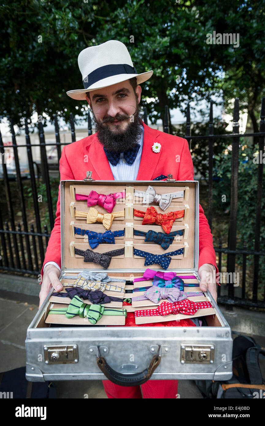 Bedford Square, Bloomsbury, London, 19th April 2014.  Mikhail Korausch displays his colourful, handmade bow ties - Stock Image