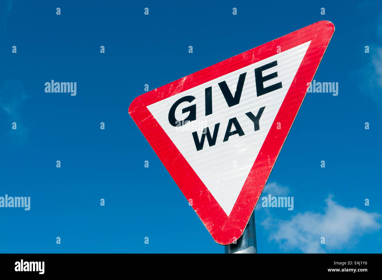 Give Way sign against a blue sky Stock Photo