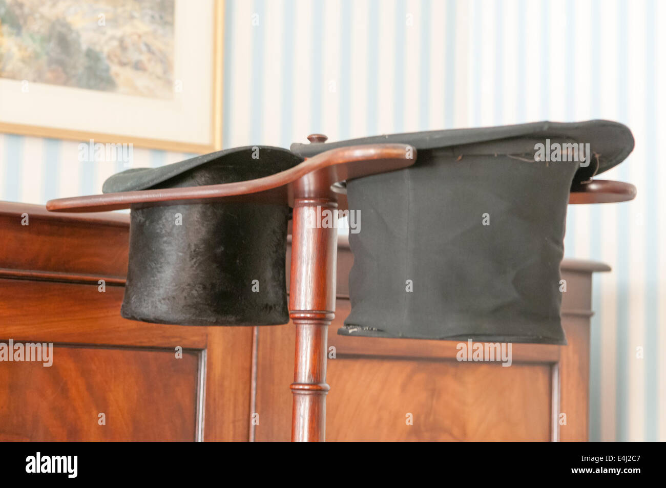 A gentleman's stand for two top hats. - Stock Image