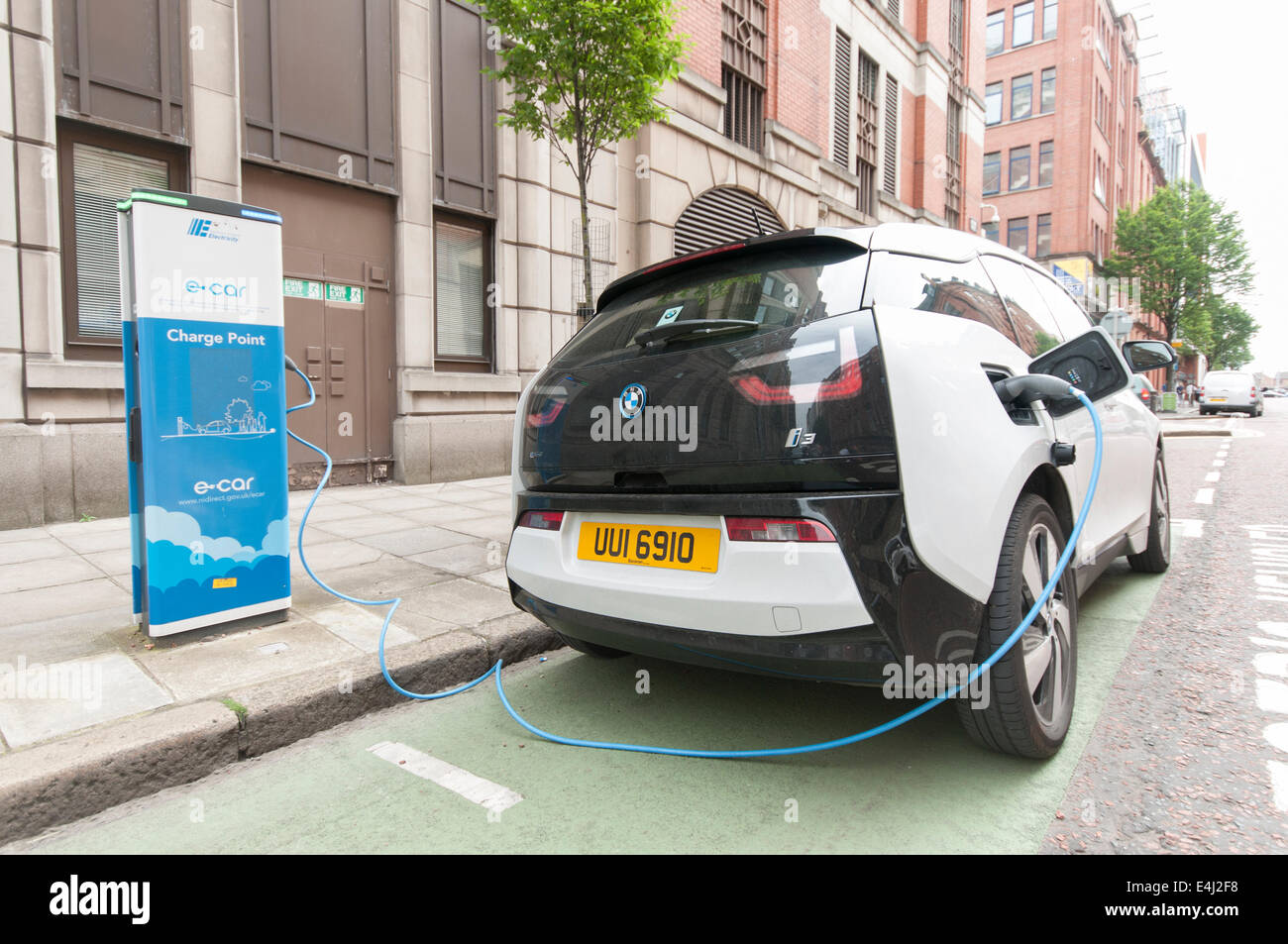 Bmw I3 Electric Car Plugged Into A Public Charging Station At A