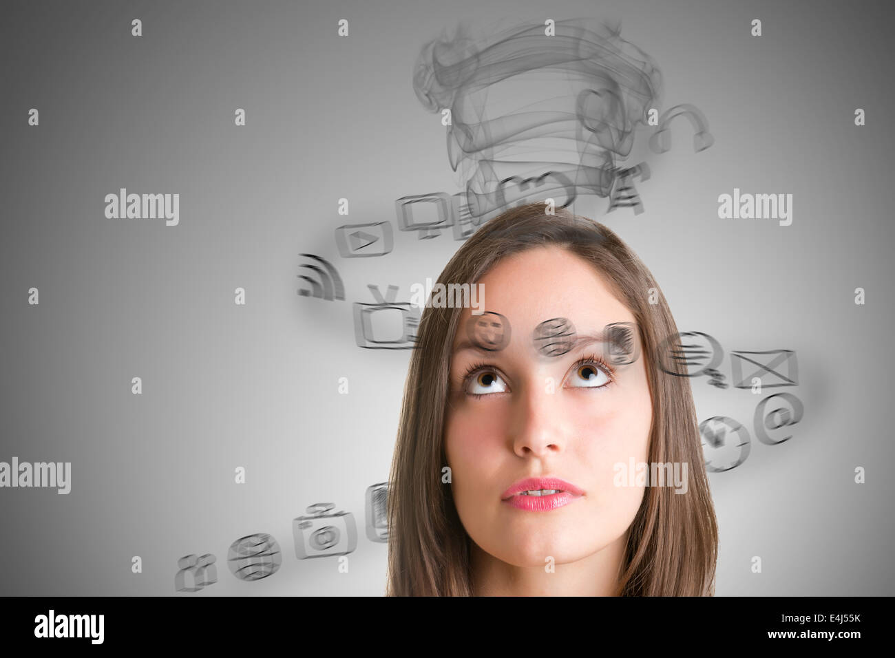 Young woman stressed with social media - Stock Image