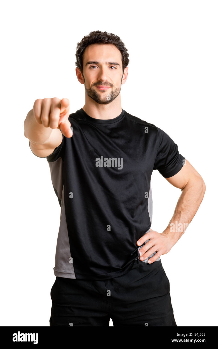 Personal trainer pointing at viewer, isolated in white - Stock Image