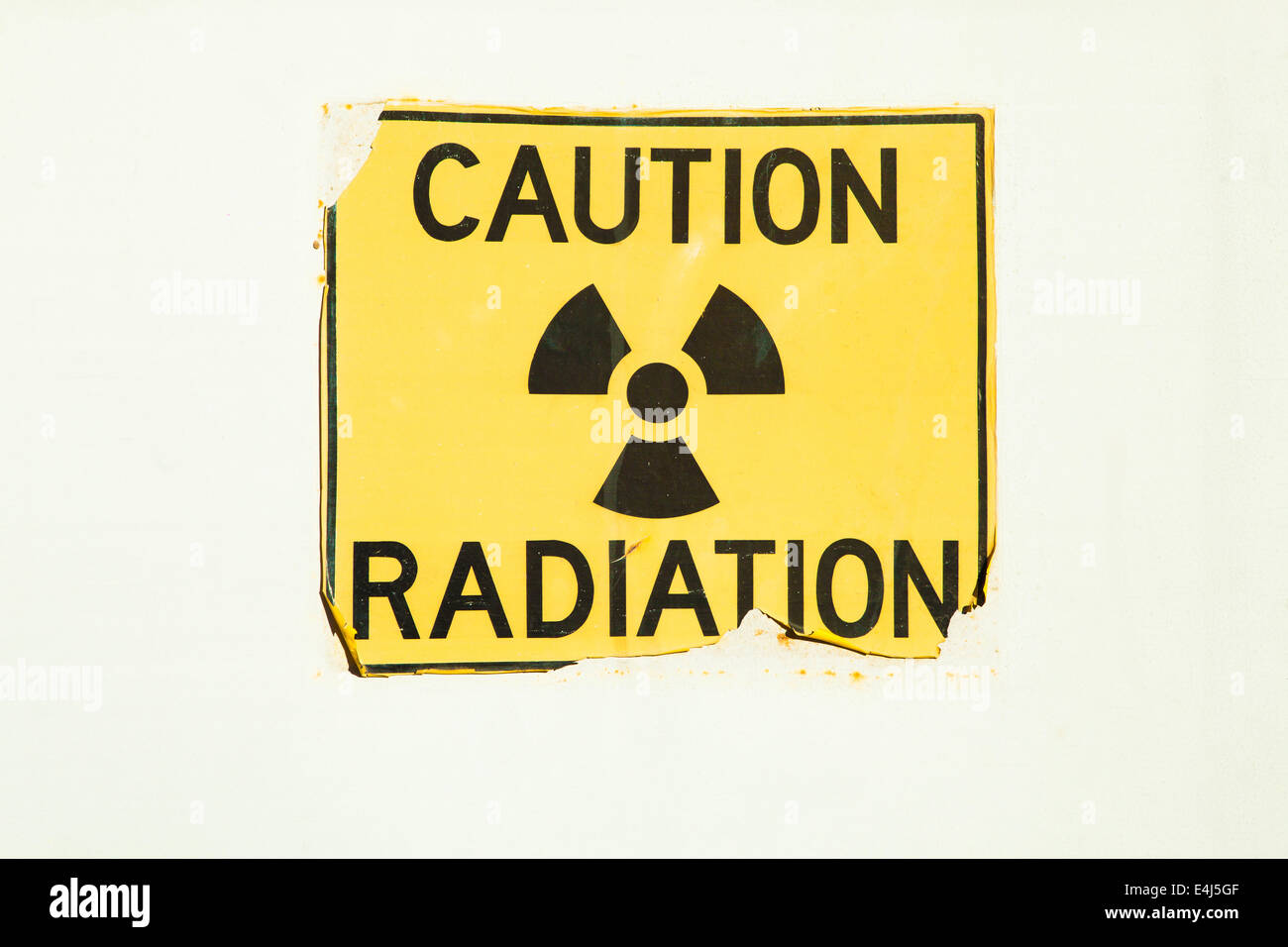 An old radiation warning sign on a door - Stock Image