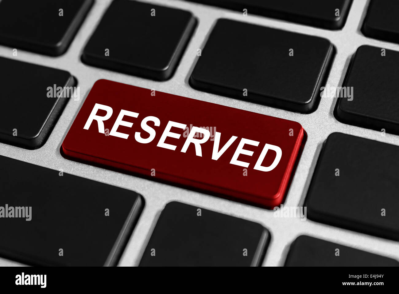 reserved red button on keyboard, business concept - Stock Image