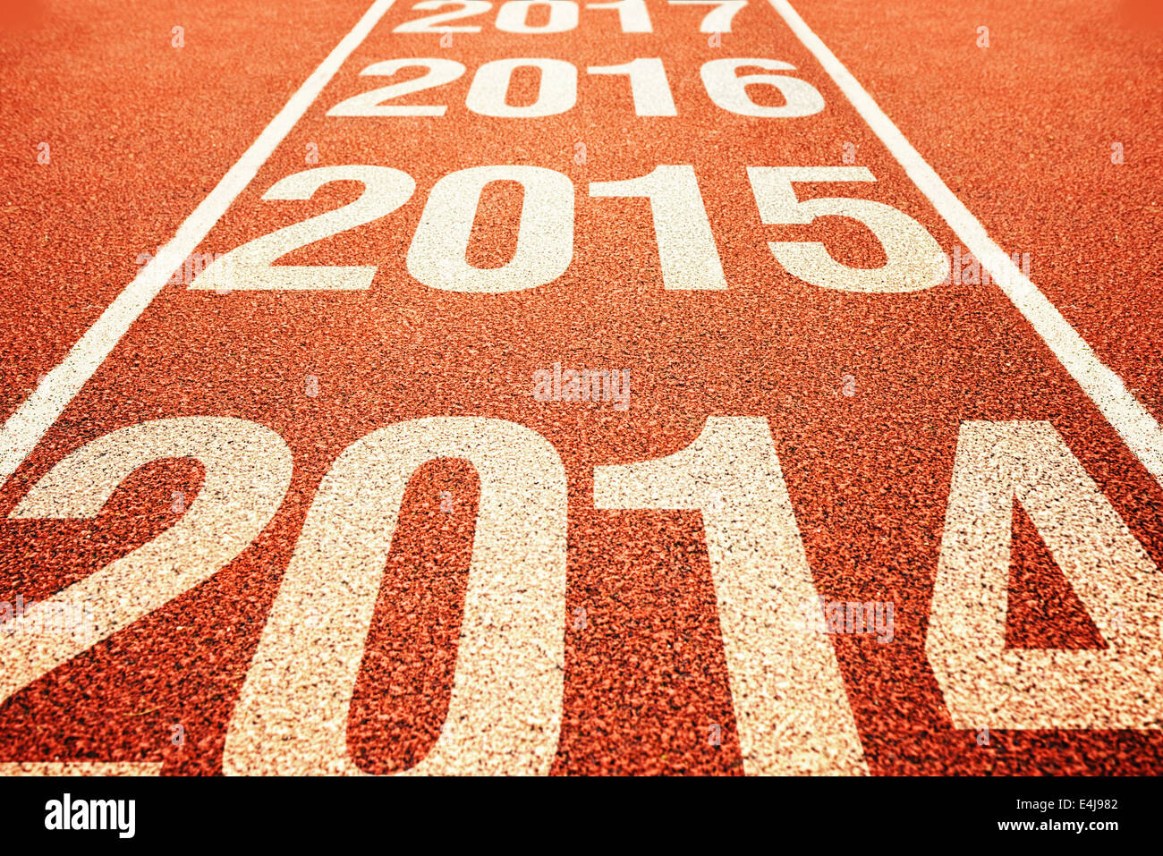 Number 2015 on athletics all weather running track with preceding and following years. Happy new 2015 year. - Stock Image