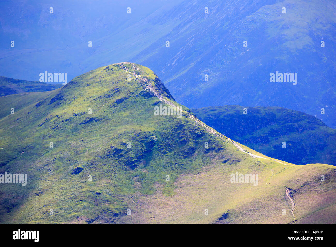 Catbells, Lake District, Cumbria. A distant view of the footpath to the top of the popular fell. - Stock Image