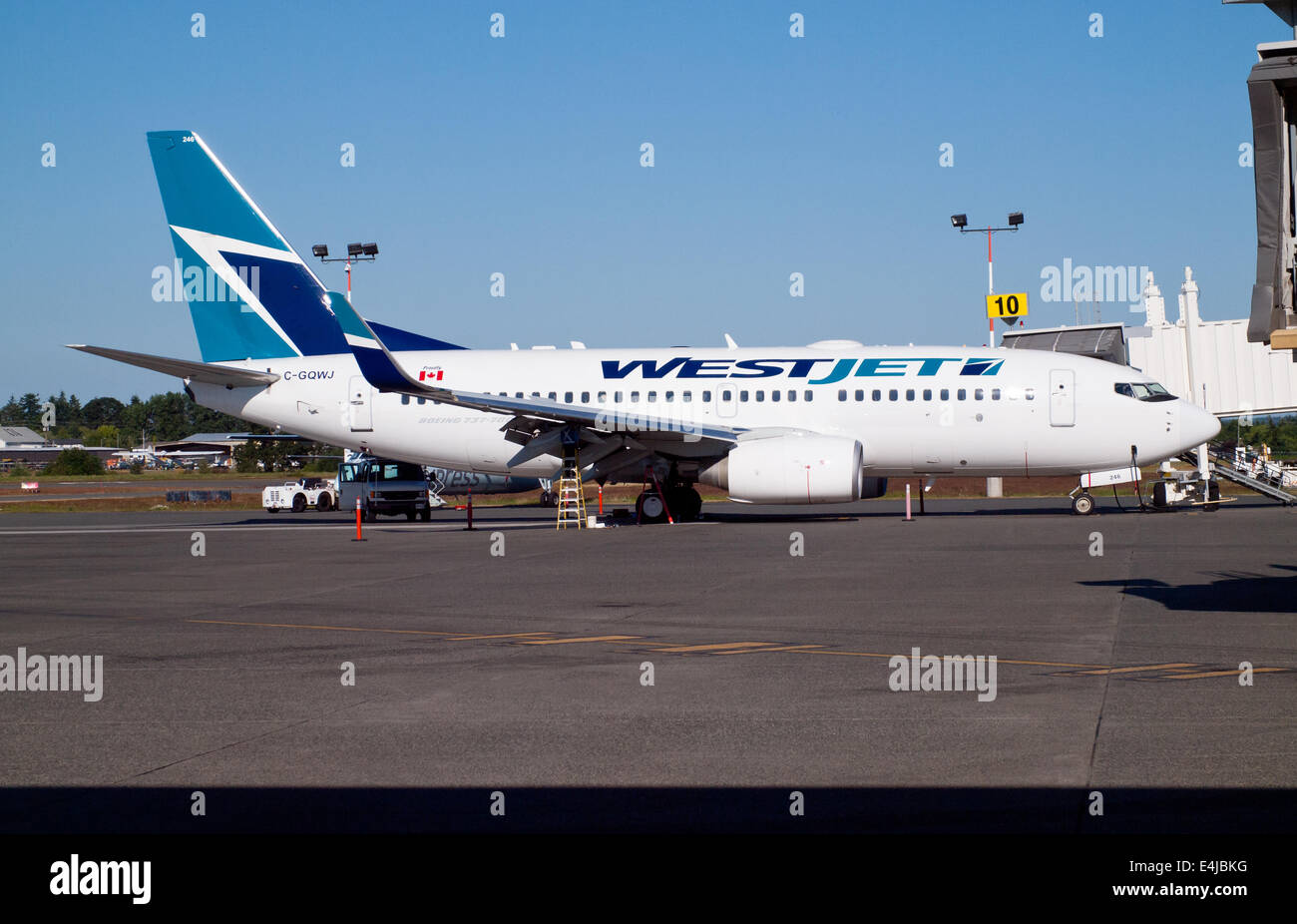 A WestJet Airlines Boeing 737-700 parked on the tarmac at Victoria International Airport (YYJ) in Sidney, BC, Canada. - Stock Image