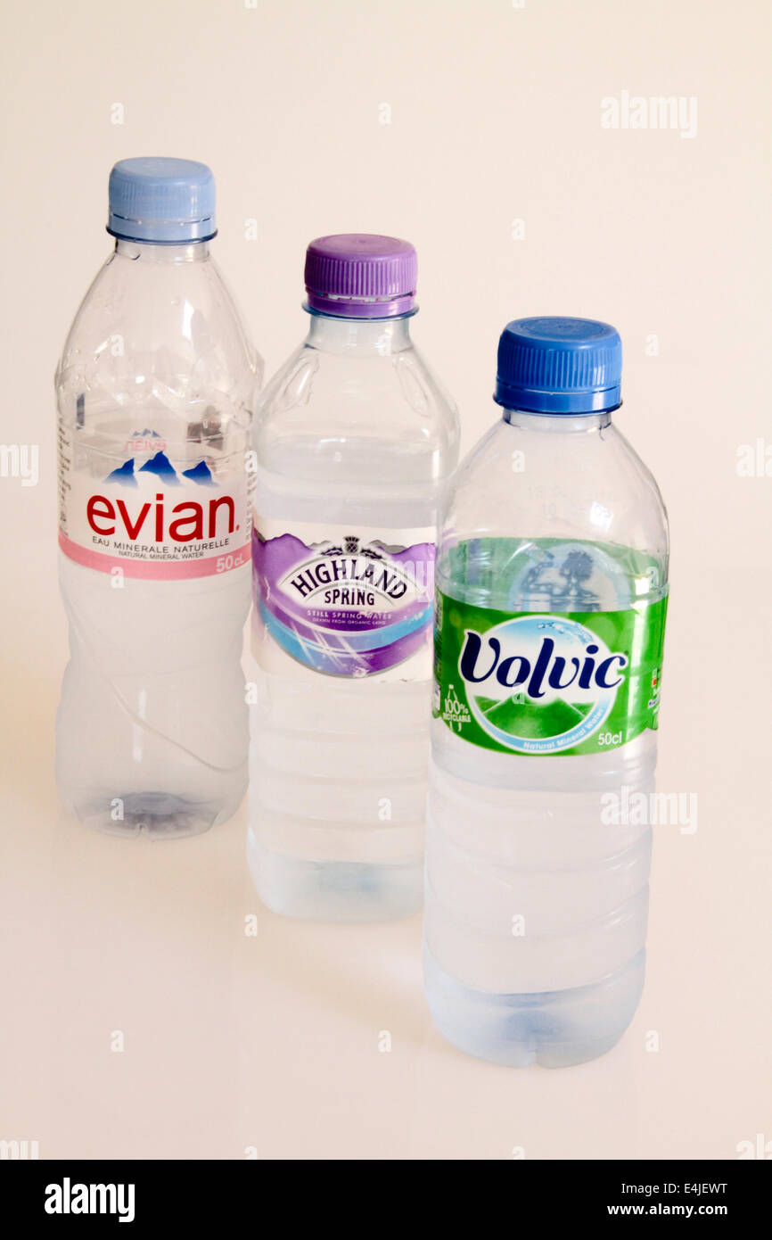 A selection of different bottled waters Evian, Highland Spring and Volvic - Stock Image
