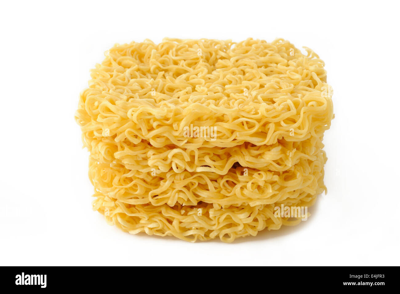 Dried noodles on white background - Stock Image
