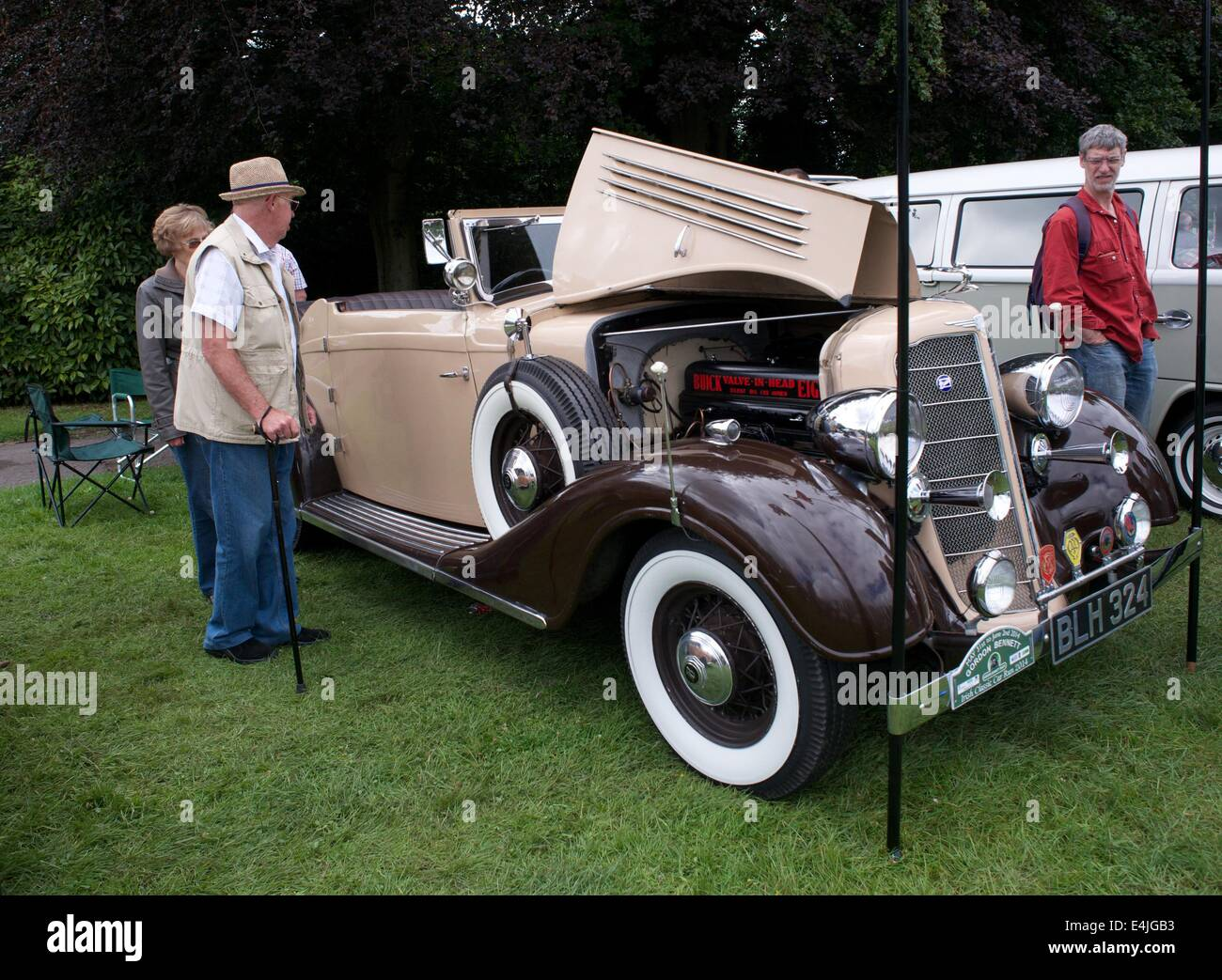 Manchester, UK  13th July 2014 An elderly man looks at a 1934 McLaughlin Buick (Albermarle) Series NA50 Model 58 - Stock Image