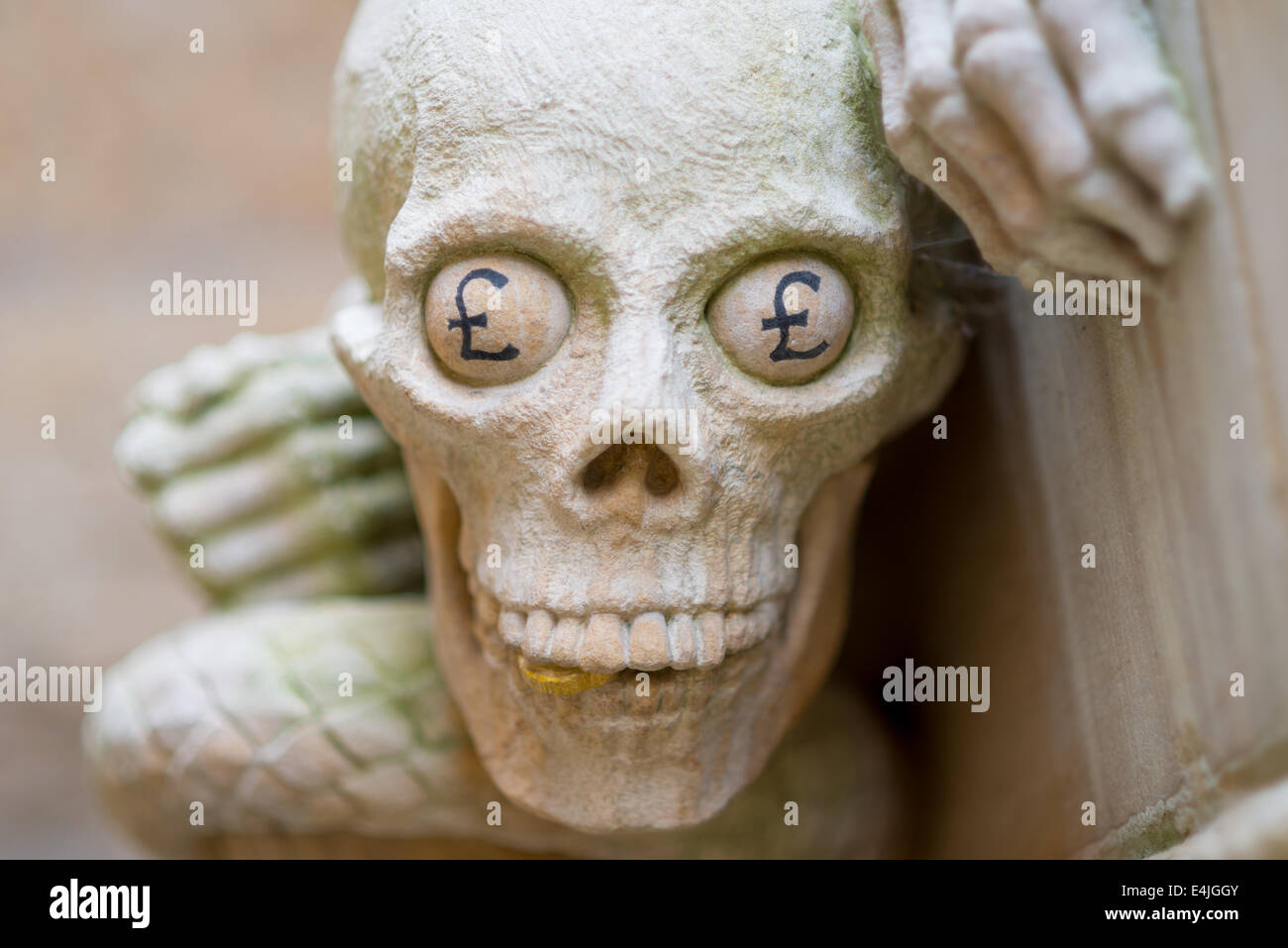 A gargoyle at Lincoln Cathedral with Pound Sings for eyes. - Stock Image
