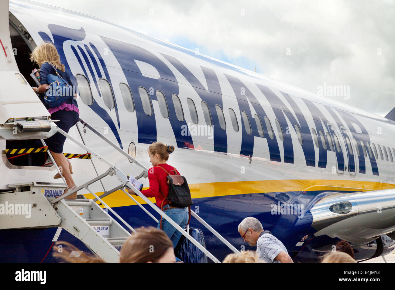 Passengers boarding a Ryanair plane at Stansted airport, London UK - Stock Image