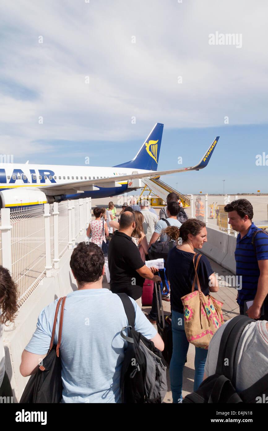 Queue to board a Ryanair plane , Faro airport, Algarve, Portugal - Stock Image