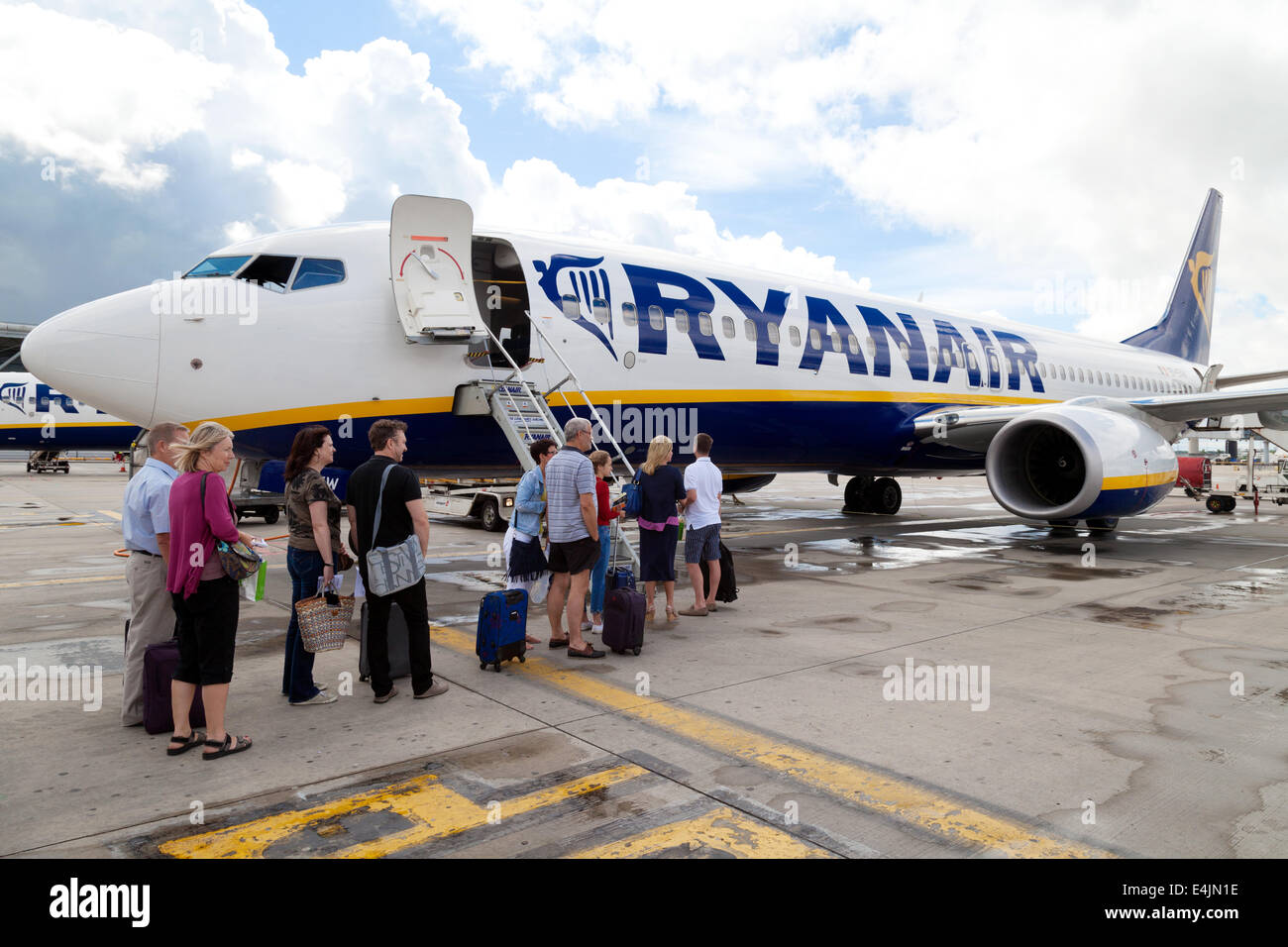 Ryanair plane at Stansted Airport UK with passengers boarding - Stock Image