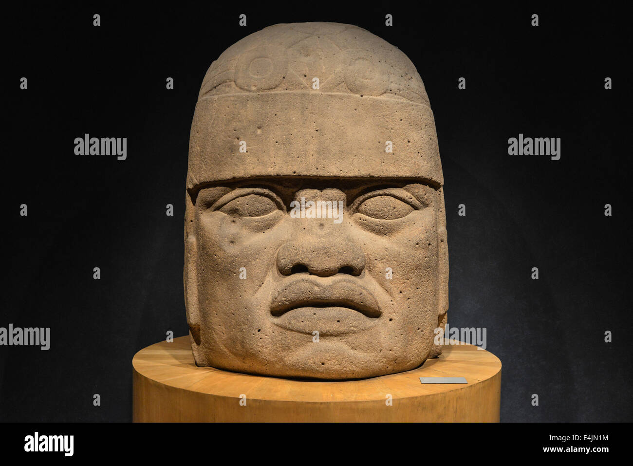 An Olmec colossal head sculpted from a large basalt boulder. The head dates from at least before 900 BC and is a - Stock Image