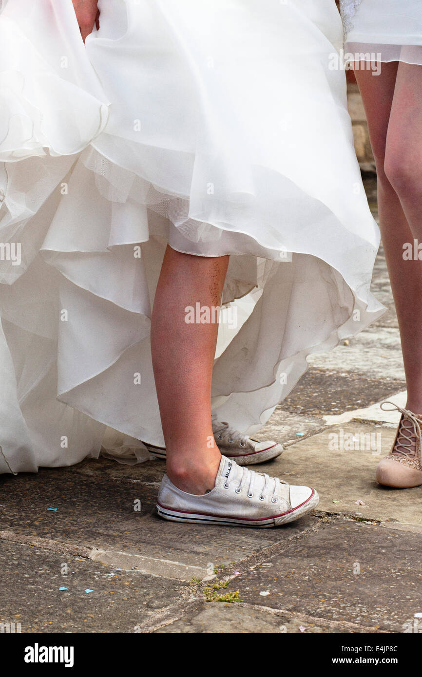 Bride wearing converse trainers for