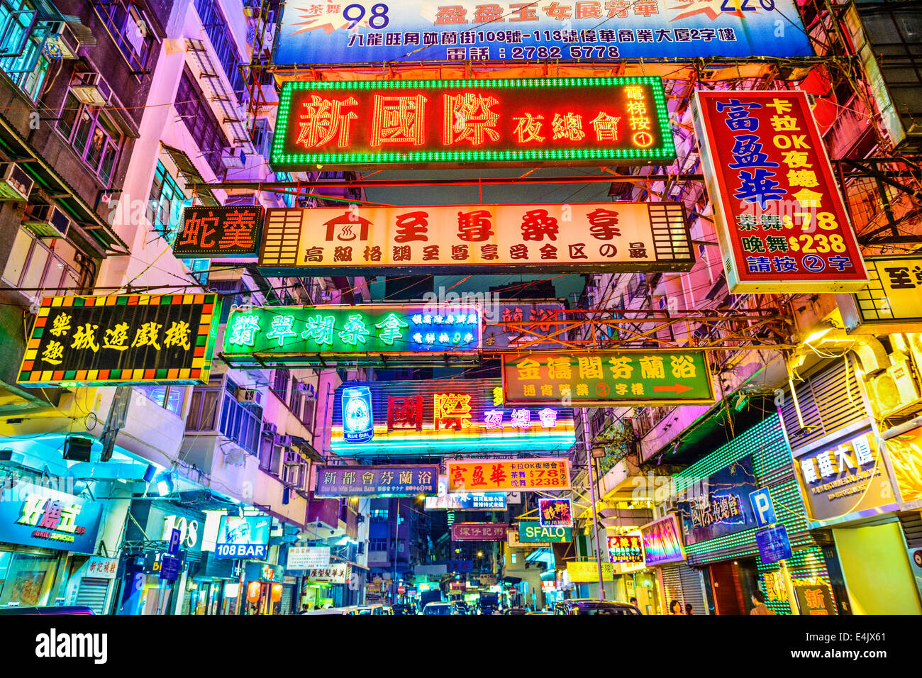 HONG KONG, CHINA - MAY 16, 2014: Signs illuminate the night in Kowloon. Hong Kong is well known for the myriad of - Stock Image