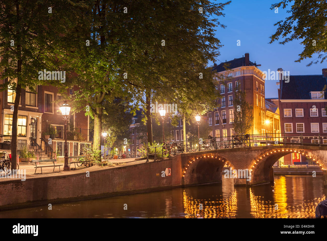 Amsterdam Canal romantic bench from The Fault in Our Stars TFiOS on the Leidsegracht Canal at night evening Amsterdam - Stock Image