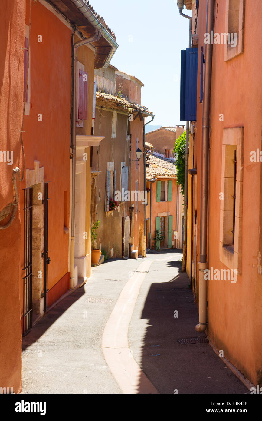 Little lane with red houses in French Roussillon - Stock Image