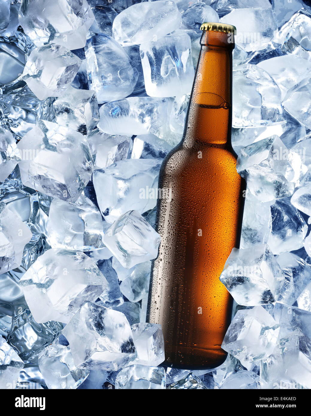 Bottle of beer in ice cubes. - Stock Image