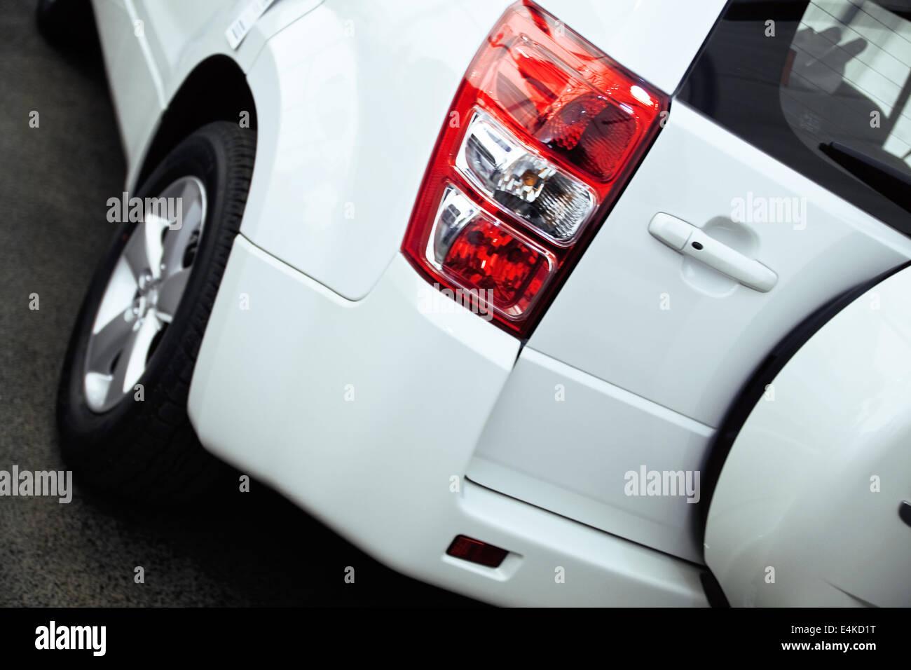 red rear lights of modern passenger car - Stock Image