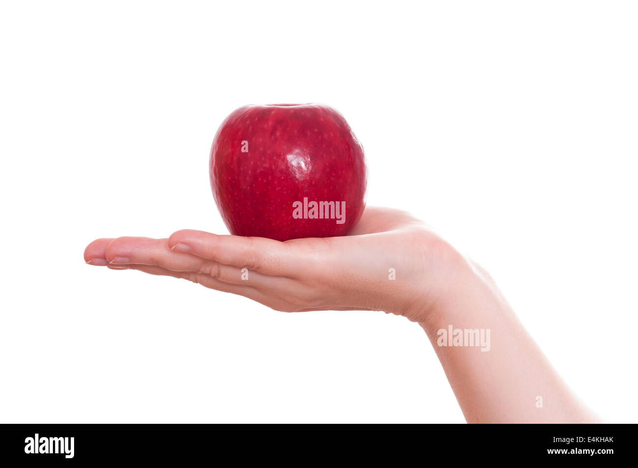 Red apple in a hand Stock Photo