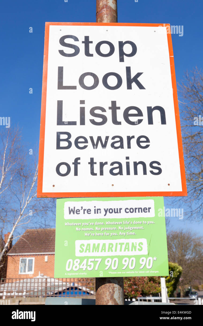 Stop Look Listen. Beware of trains sign at a railway crossing in Nottinghamshire, England, UK - Stock Image
