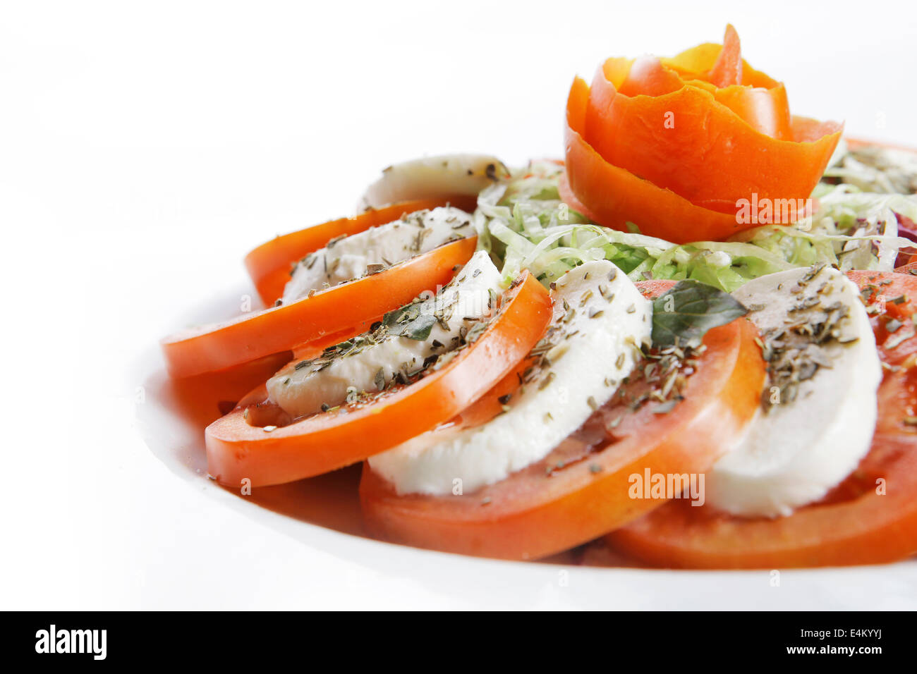 a plate of tomatoe and white cheese with styling - Stock Image
