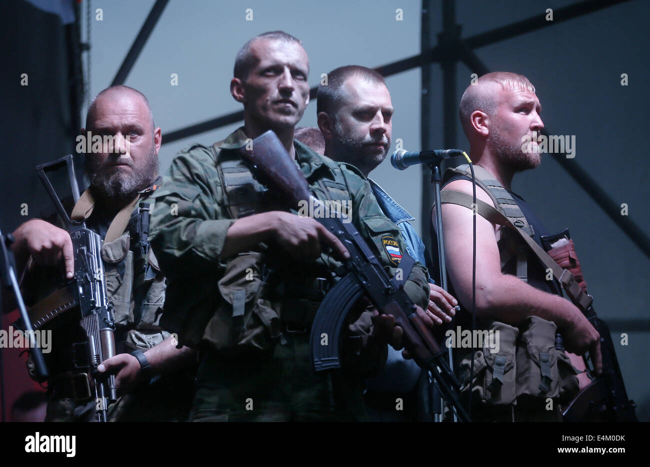 Donetsk, Ukraine. 13th July, 2014. Donetsk People's Republic governor Pavel Gubarev (2nd R) speaks at a rally - Stock Image