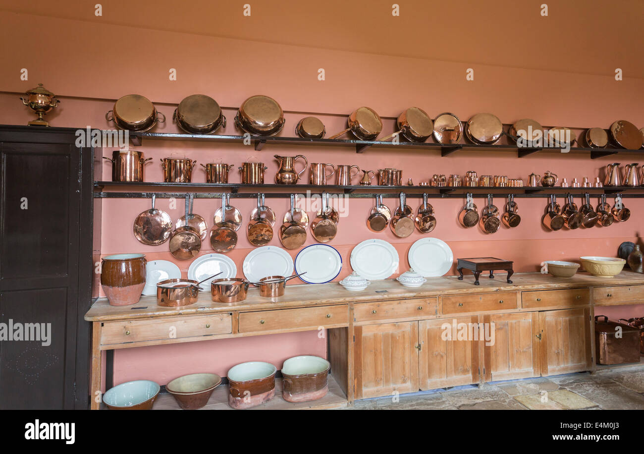 Shiny copper kitchen utensils, pots, pans, saucepans, jugs, white dinner and serving plates, kitchen, Felbrigg Hall, - Stock Image