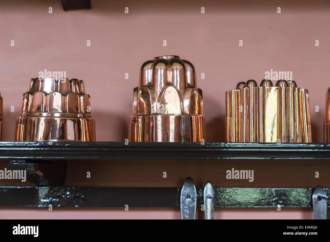 Shiny Copper Jelly Moulds On A Shelf At Felbrigg Hall Norfolk Uk