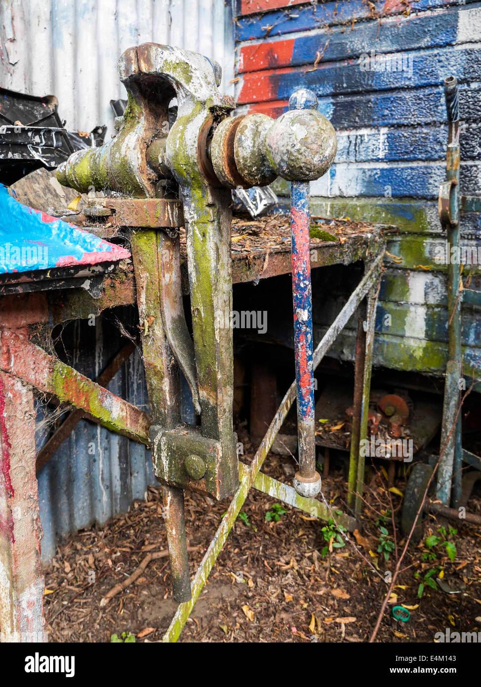 Vintage Leg Vice outside Artist's studio workshop with paint covered work bench, Eel Pie Island, Twickenham, - Stock Image