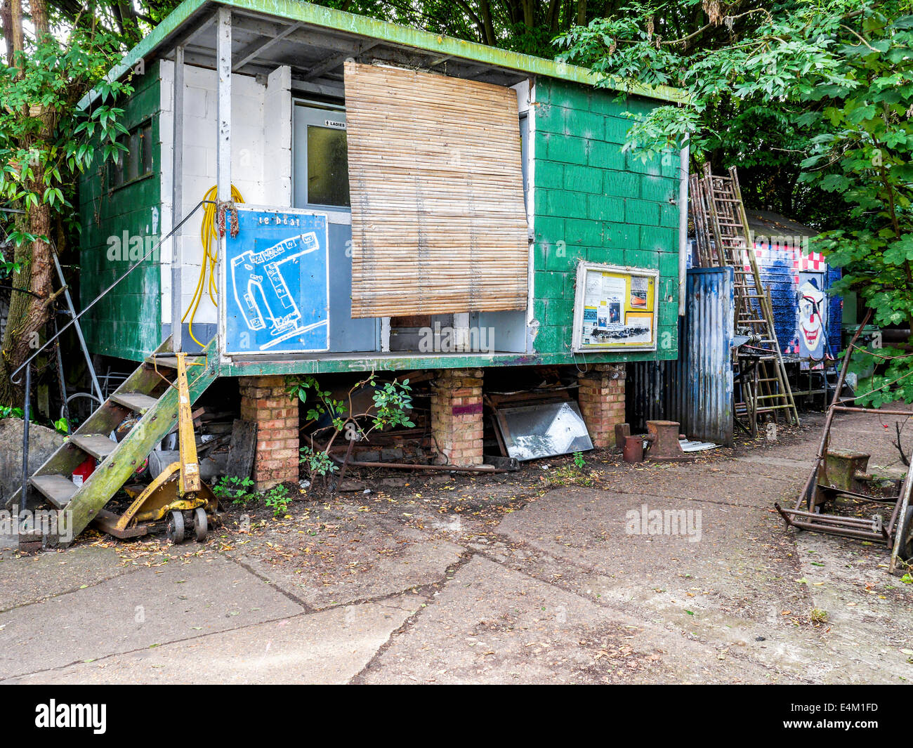 Quirky Artist's studio with colorful exterior and map of the yard in the working Boatyard on Eel Pi Island, - Stock Image