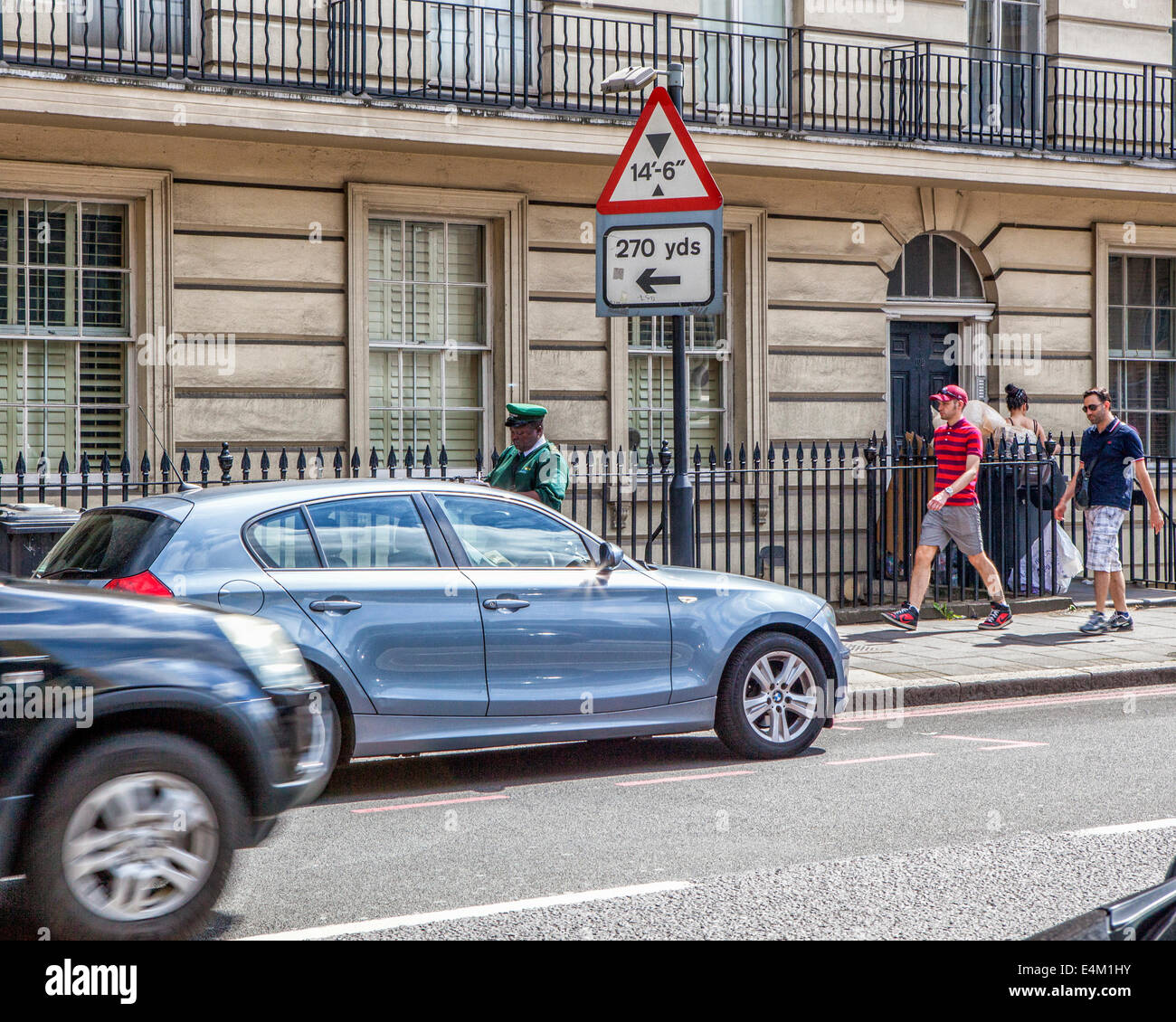 Traffic warden issuing PCN for illegally parked car - London UK - Stock Image