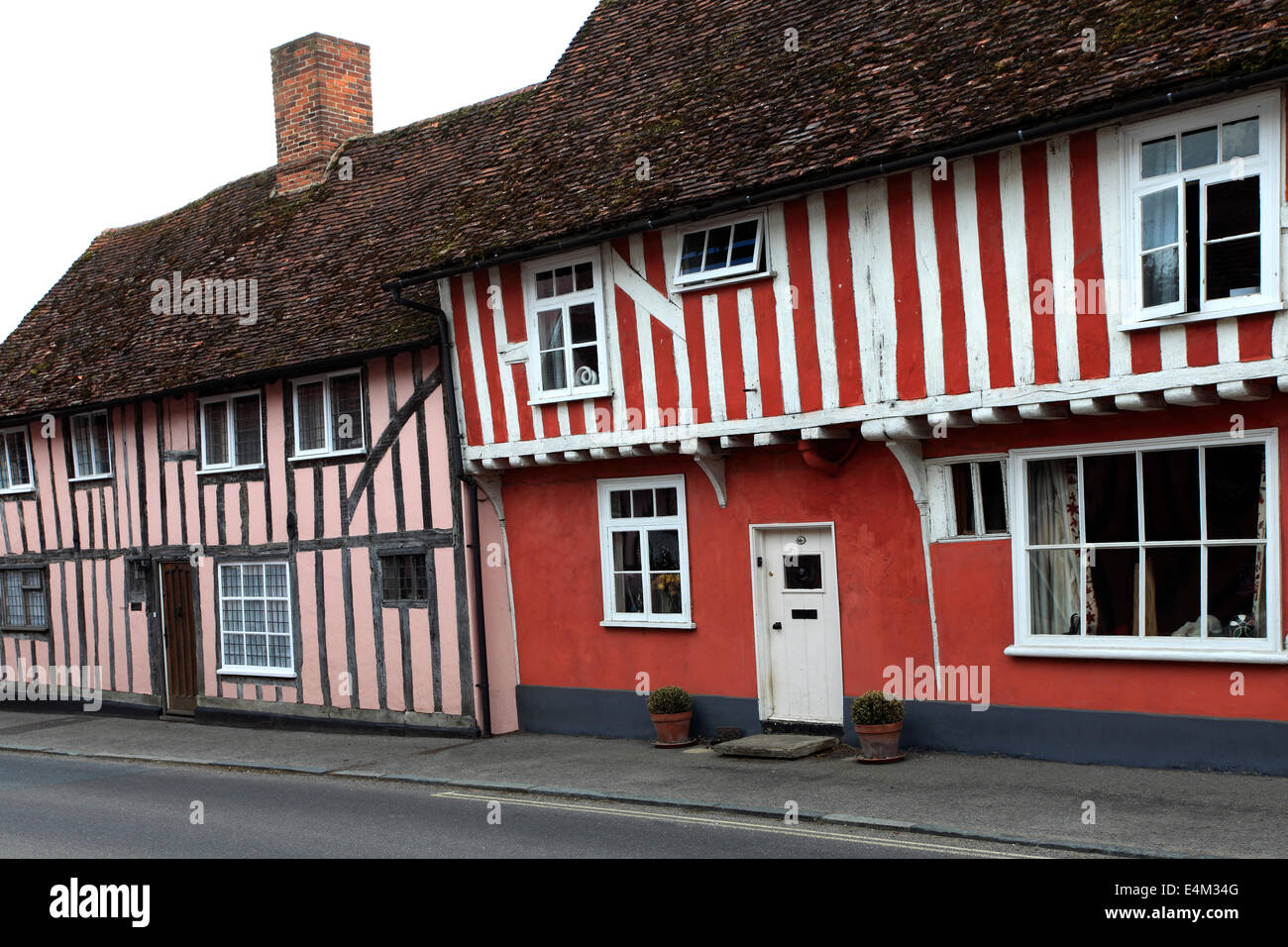 Colorful Half Timber Built Thatched Cottages, Lavenham village, Suffolk County, England, Britain. - Stock Image