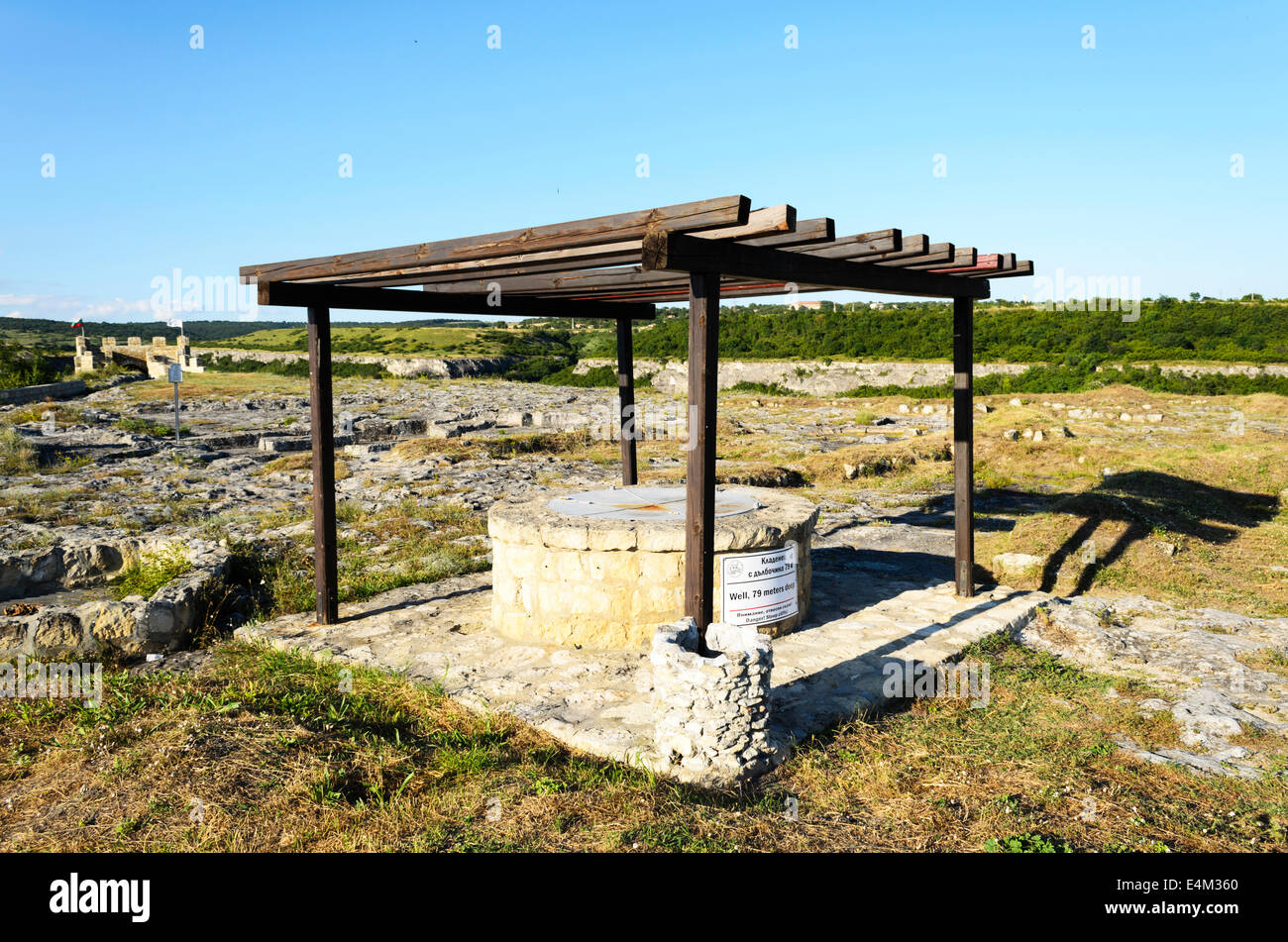 Old stone draw well for obtaining water Stock Photo