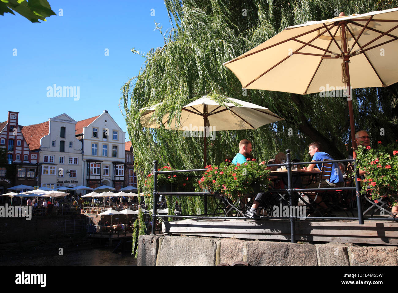 Beer garden at the old harbor, Lueneburg, Lower Saxony, Germany, Europe - Stock Image