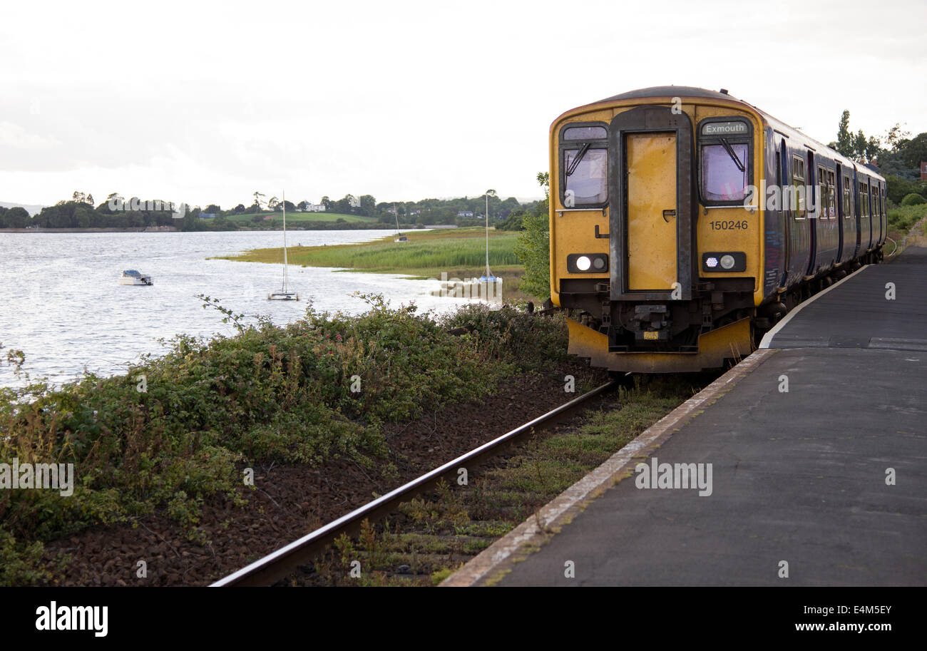 First Great Western Passenger train operating on the Avocet Line at Exton Station alongside the River Exe in Devon - Stock Image