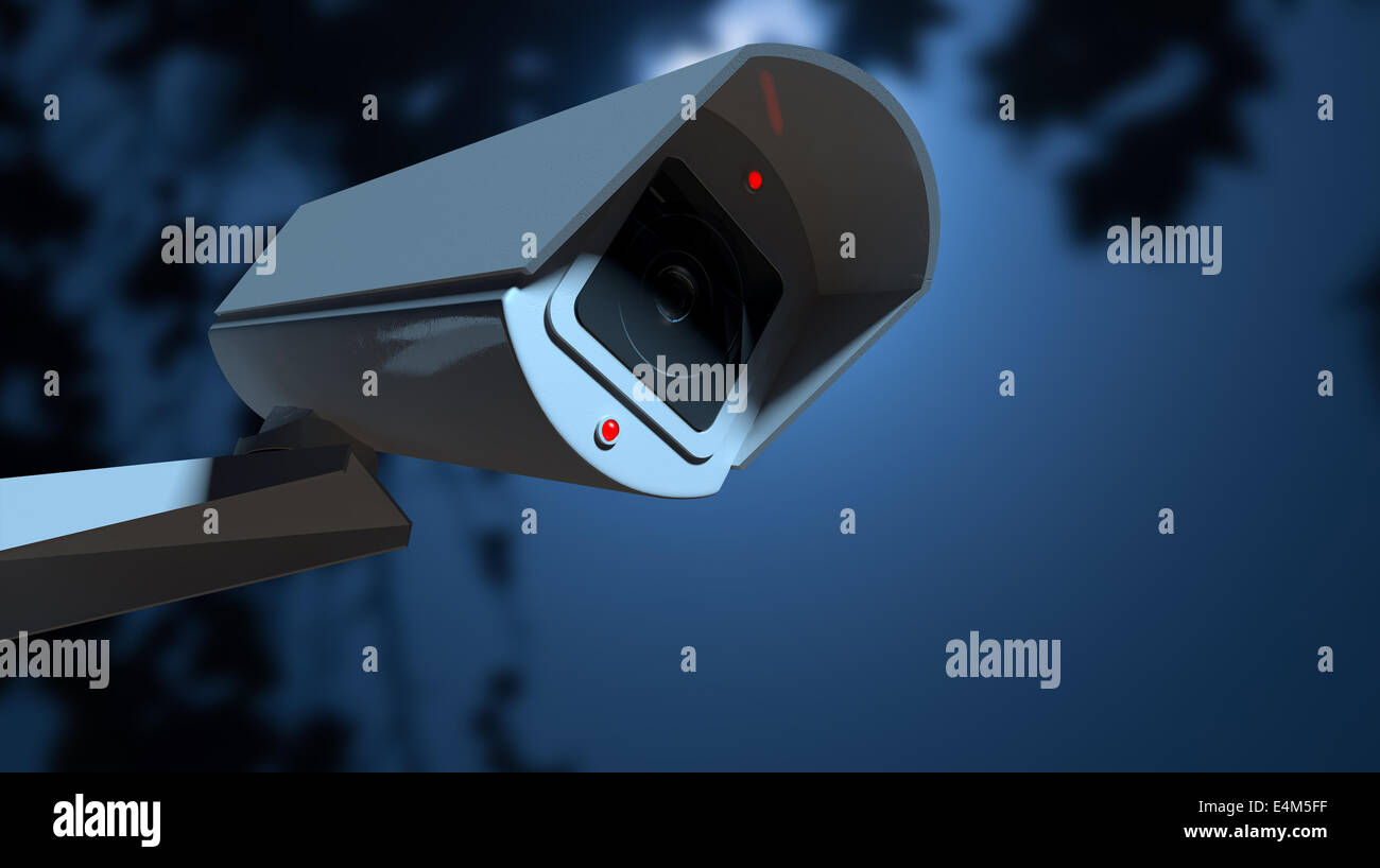 A white wireless surveillance camera with illuminated lights mounted on a wall in the night-time with copy space - Stock Image