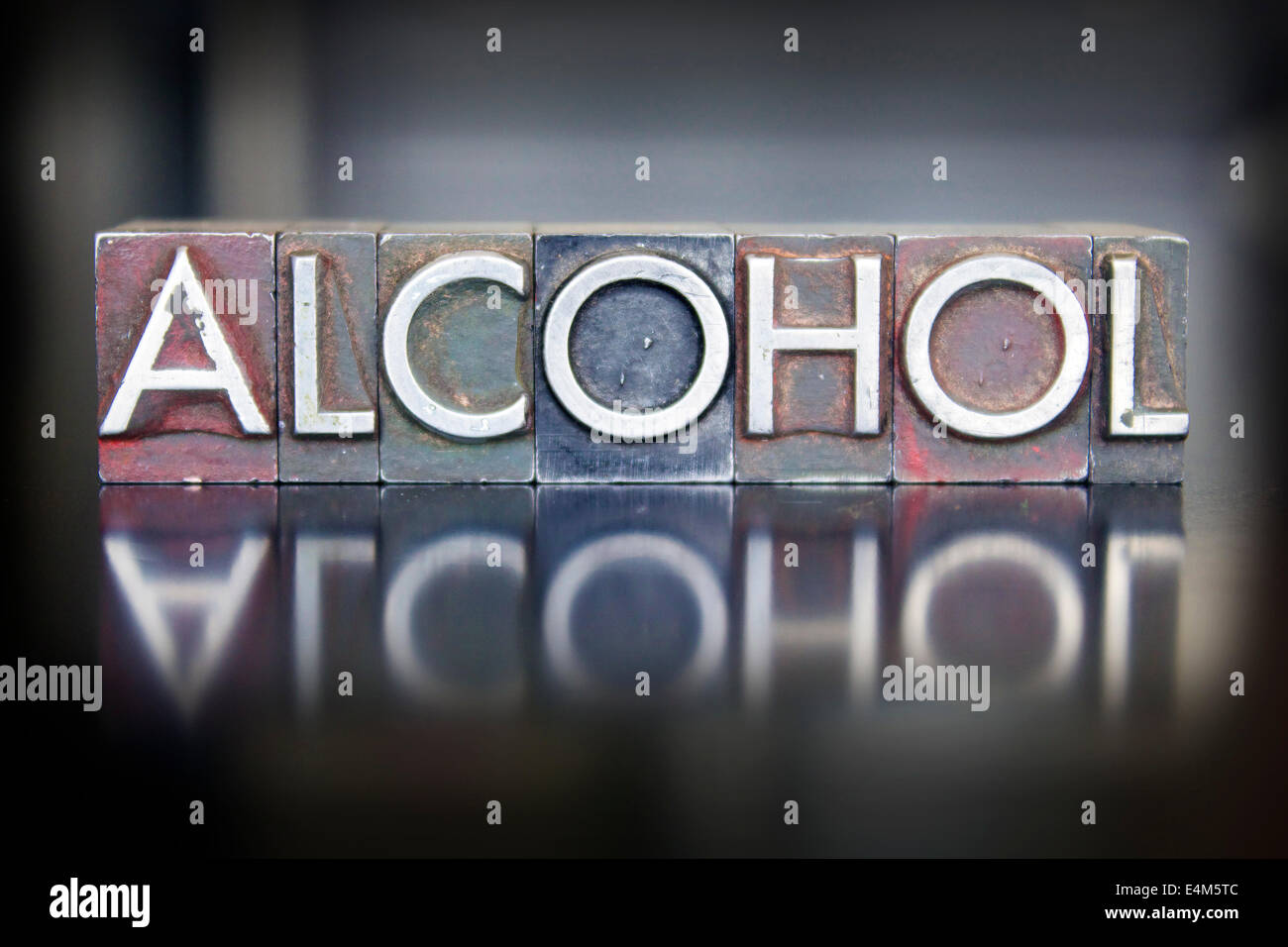 The word ALCOHOL written in vintage lead letterpress type - Stock Image