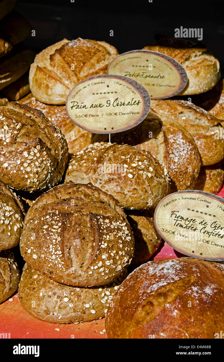 A selection of artisan bread on a market stall at the Saturday market in Chamonix, Haute Savoie, France. - Stock Image